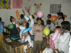 Image of children playing with balloons