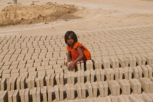 Image of a girl working in a Brick Kiln