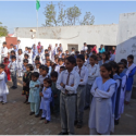 Image showing the pupils and teachers outside the school